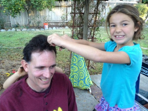 getting a haircut from my niece