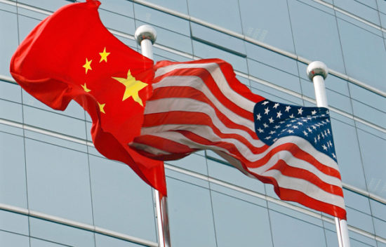 A US and a Chinese flag wave outside a c