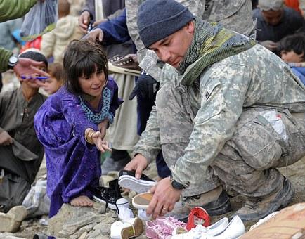 """<img src=""""organizationsthathelpveterans.jpg"""" alt=""""A Soldier Helping A Child"""">"""