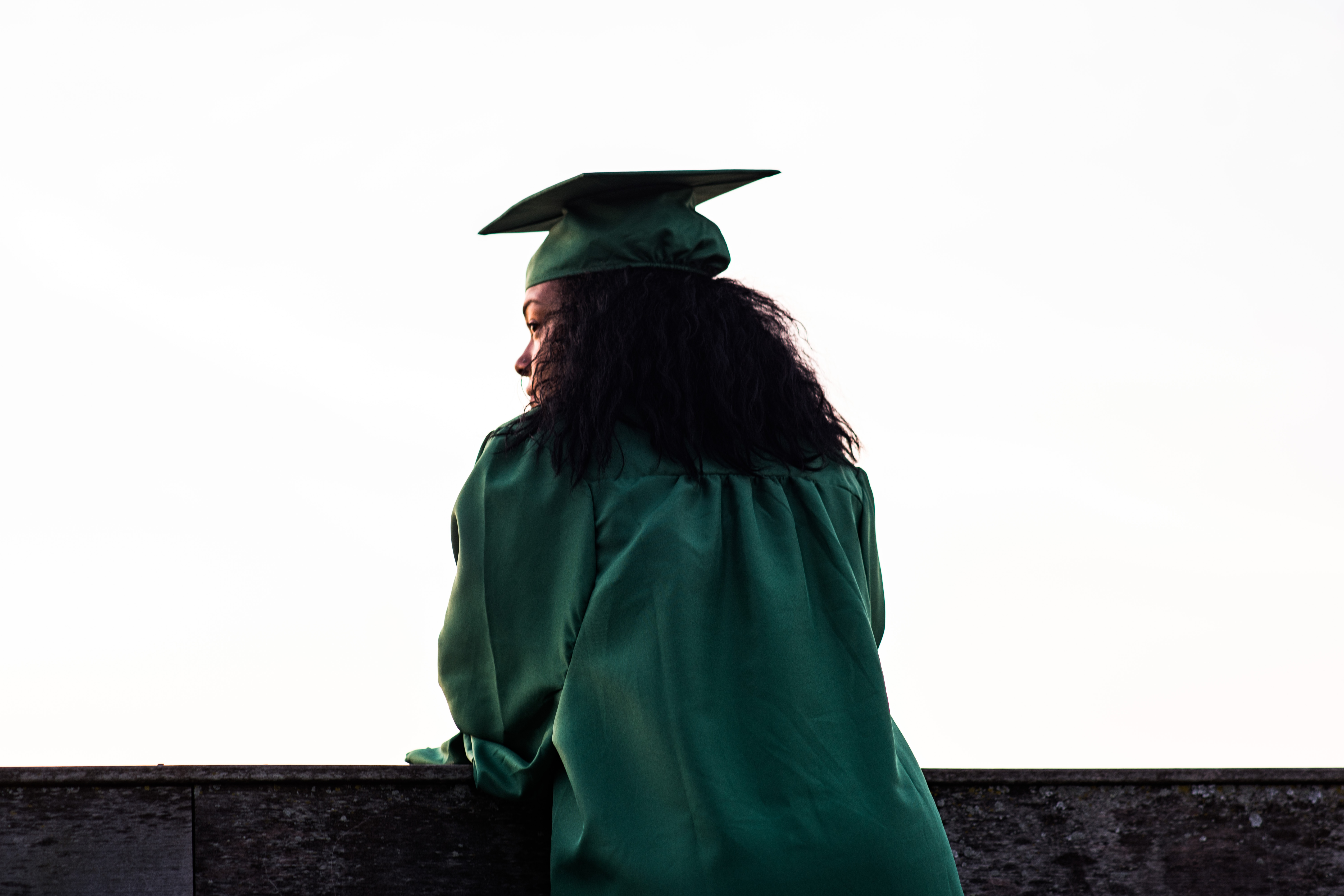 girl in cap and gown with back turned