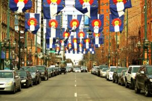 Colorado flags over Denver street.